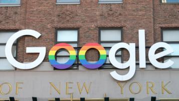 Alexi Rosenfeld/Getty Images: google logo with gender flag in oo